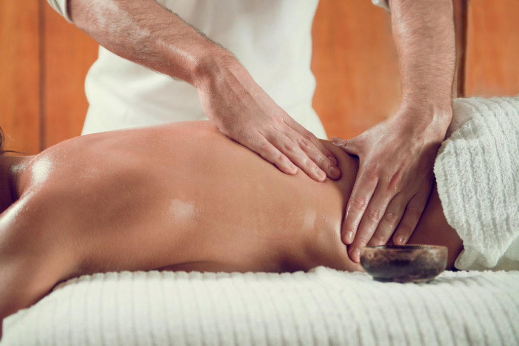 Annoyed By Back Pain? Try Yoga & Massage Before Popping a Pill - Sky Fitness Chicago